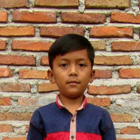Adozione a distanza: sostieni Rafel (Indonesia)