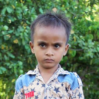 Adozione a distanza: sostieni Joni (Indonesia)